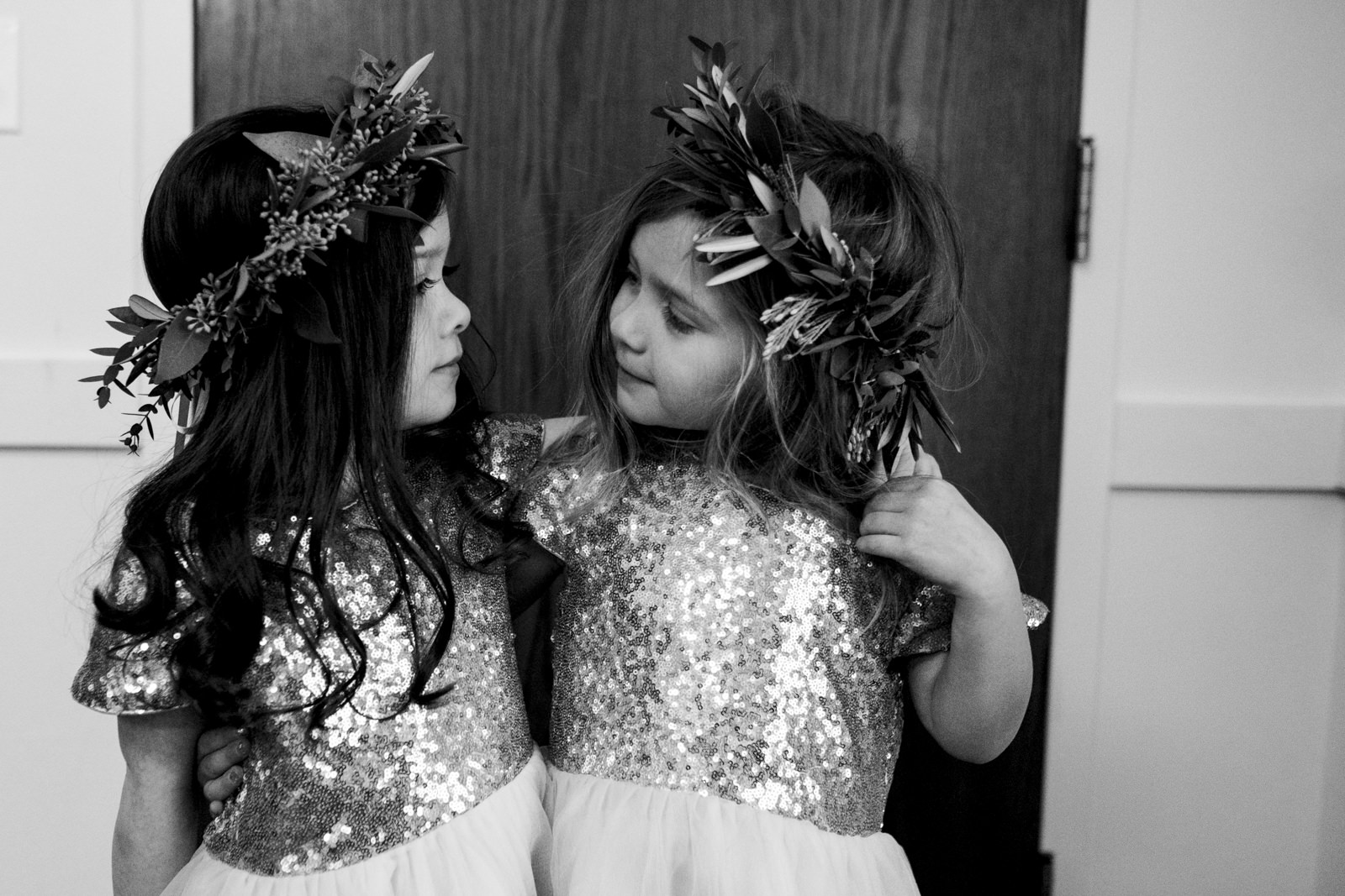 Flower girls with flower crowns and sequin dresses.