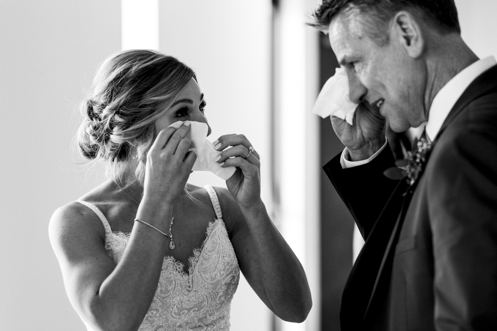 Emotional first look with bride and her father before wedding ceremony.