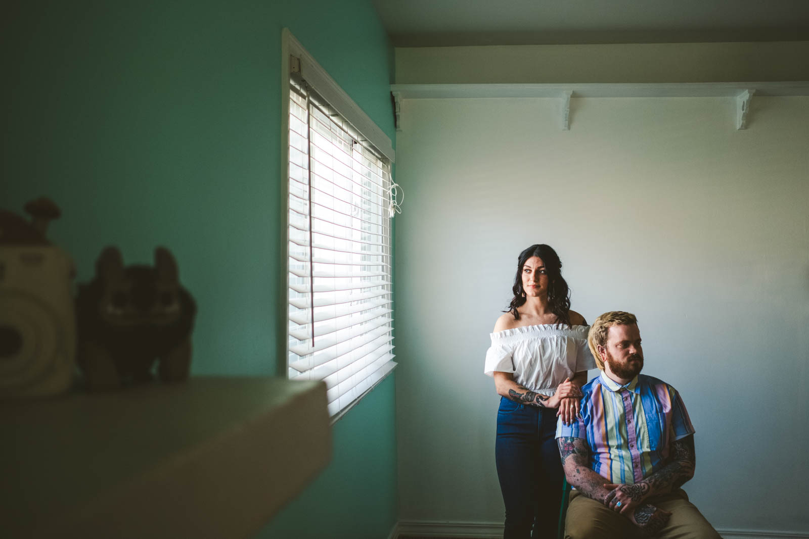 Engaged couple poses in home