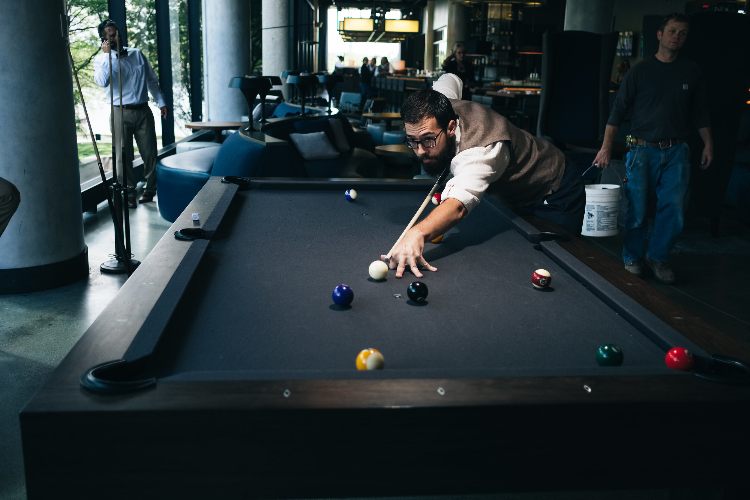 Groom Plays Pool for an Engagement Session Photograph