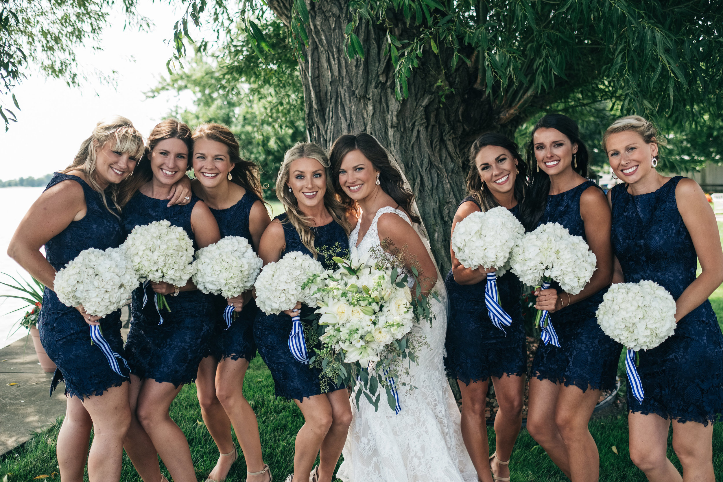Bridesmaids Stand Outdoors for Bridal Party Photos