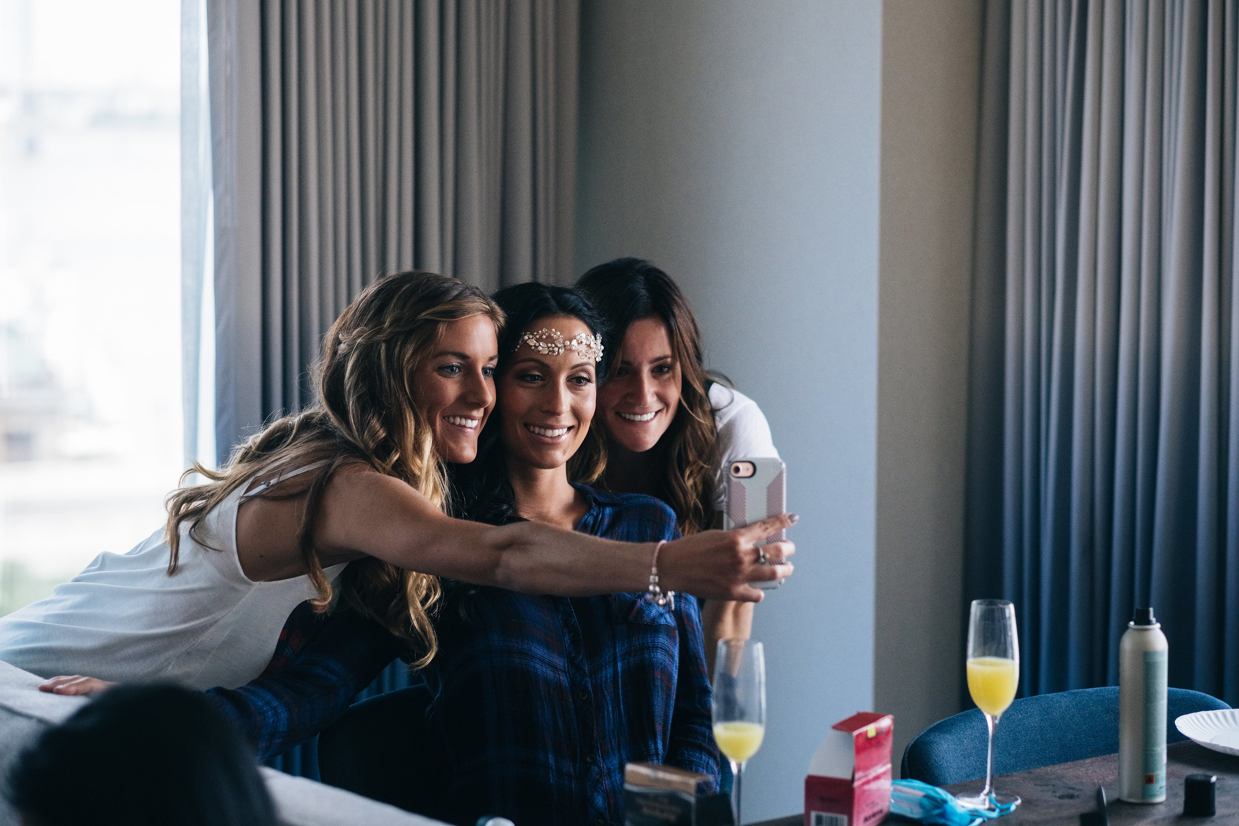 Bridesmaids Gather for Seflie on Wedding Day