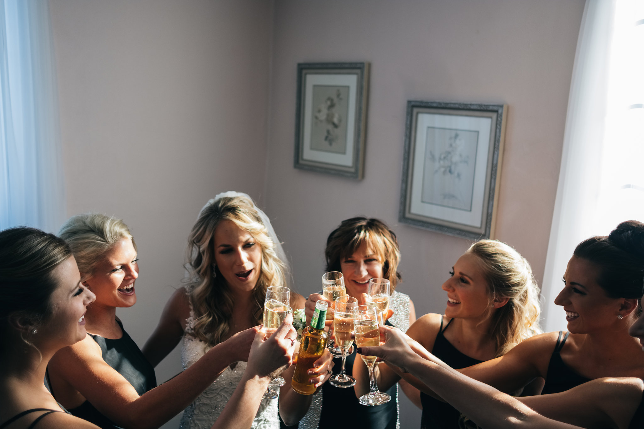 Bridesmaids Cheers to Bride on Her Wedding Day for Photo