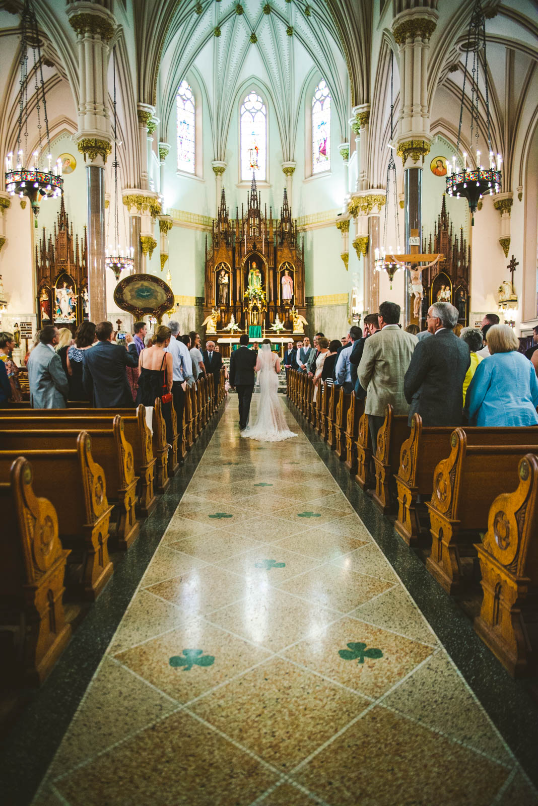 Bride Walks Down Aisle of The Historic Church of Saint Patrick with Groom on Wedding Day in Toledo Ohio