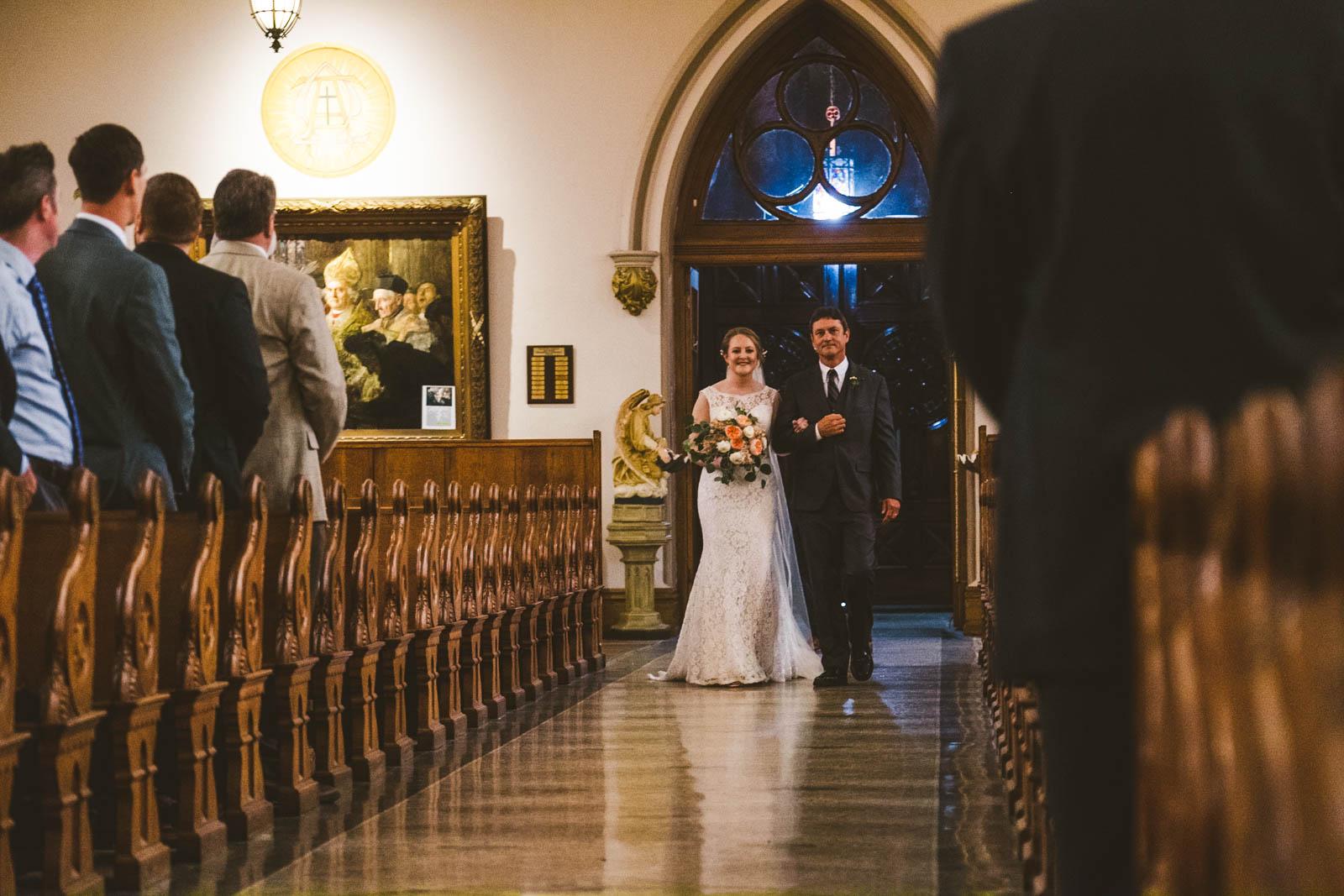Bride Walks Down Aisle of Historic Church of Saint Patrick in Toledo Ohio with Wedding Photographers