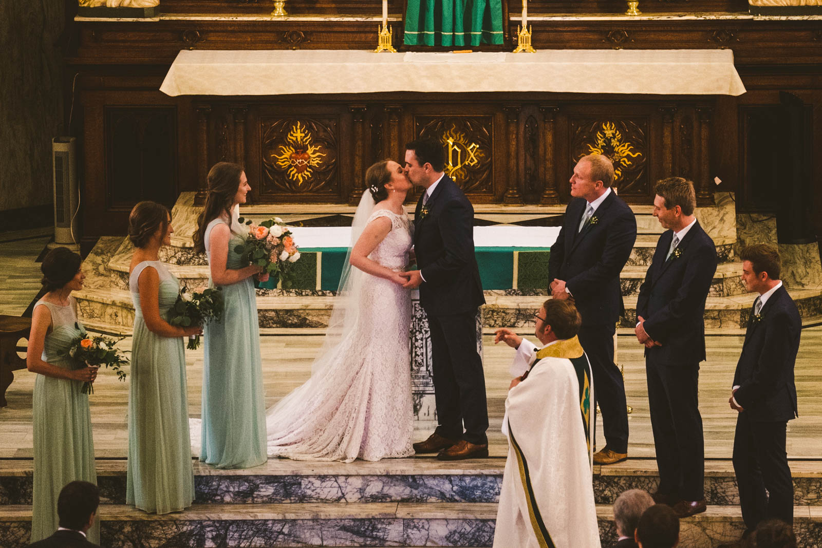 Toledo Wedding Photographers Capture Bride and Groom's First Kiss at Historic Church of Saint Patrick