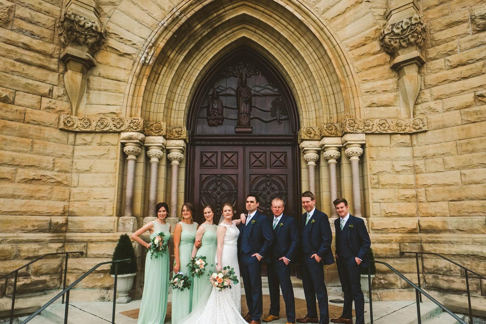 Bridal Party Pose for Toledo Wedding Photographers at Historic Church of Saint Patrick