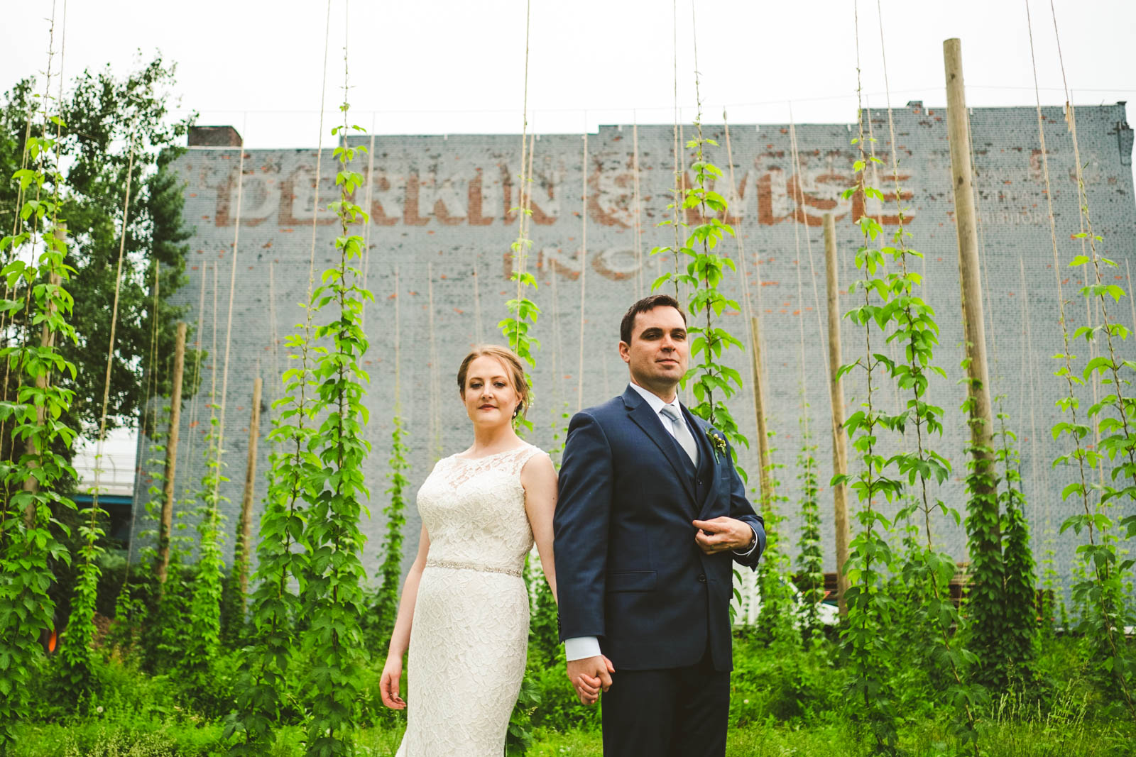 Newlyweds Pose for Toledo Wedding Photographers at Maumee Bay Brewing Company Hop Gardens