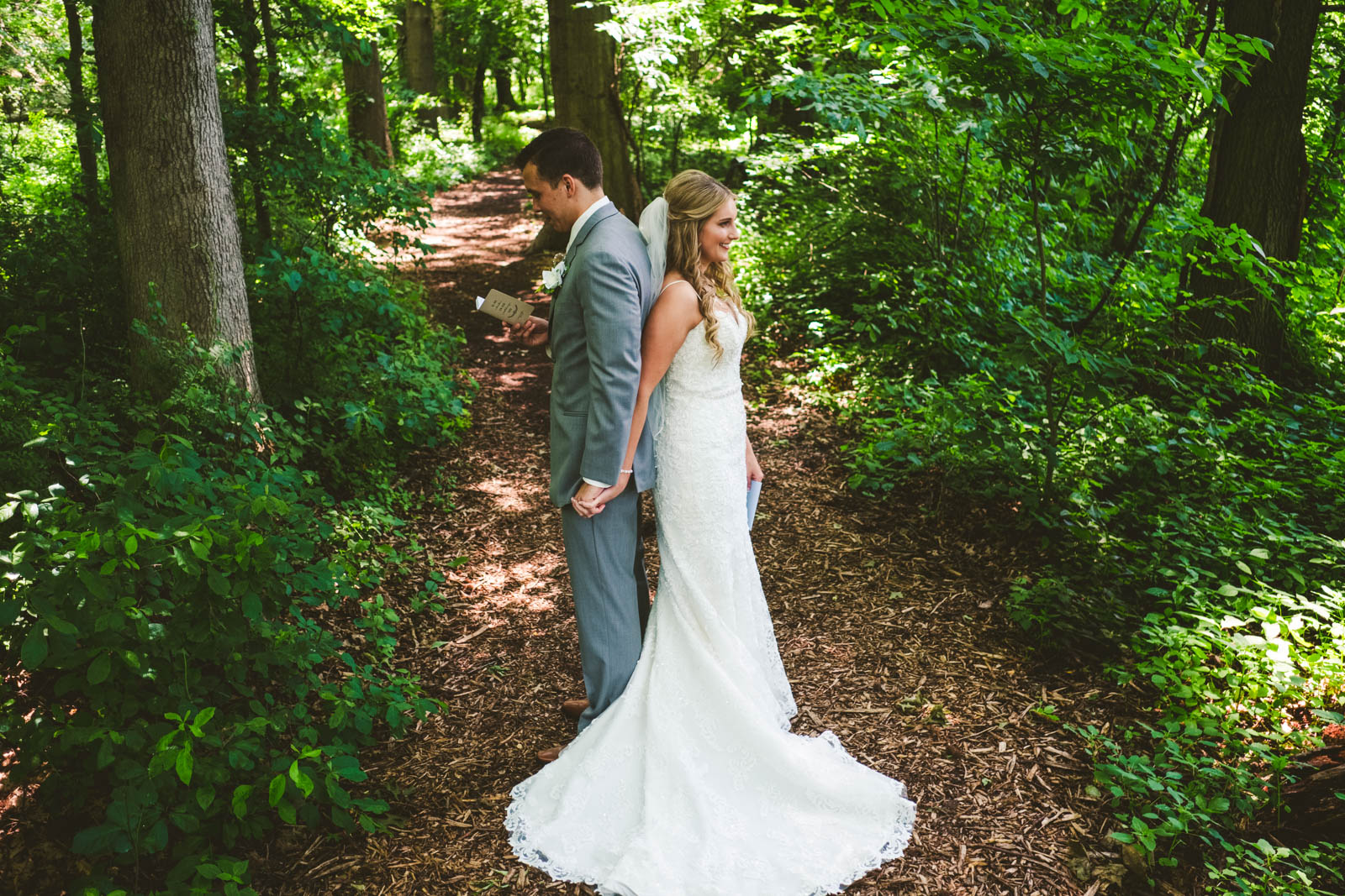 Bride and Groom Share First Look Moment Before Wedding at Stone Ridge Golf Club with Toledo Wedding Photographers