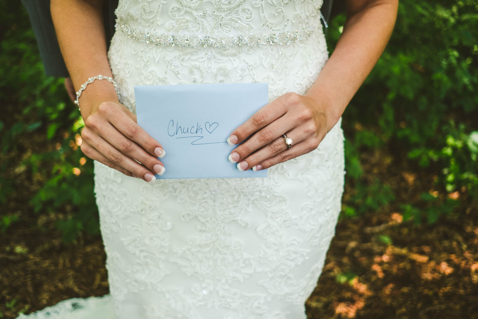 Bride and Groom Share First Look and Read Letters Before Wedding Day in Bowling Green Ohio with Toledo Wedding Photographers