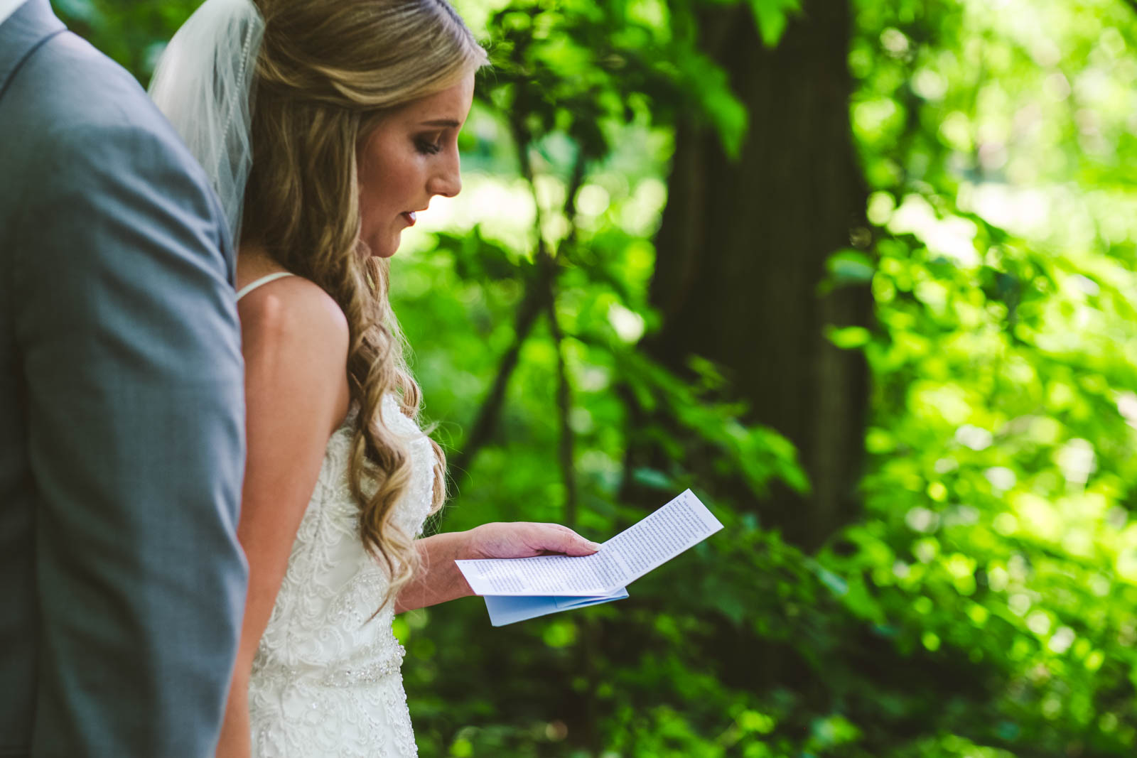 Bride Reads Letter to Groom at Winter Garden Park in Bowling Green Ohio with Toledo Wedding Photographers