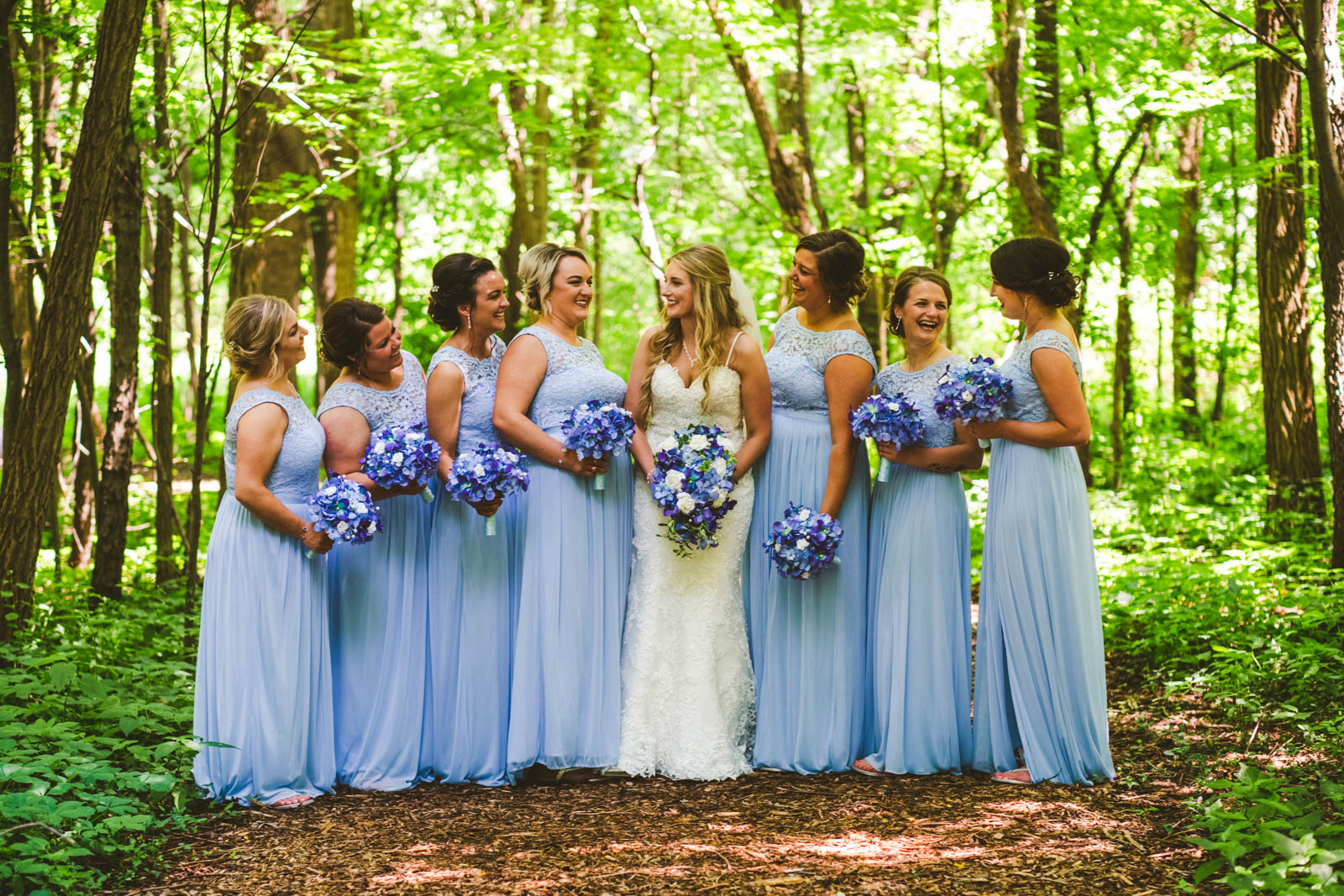Bridesmaids Pose for Toledo Wedding Photographers on Wedding Day in Bowling Green Ohio at Winter Garden Park
