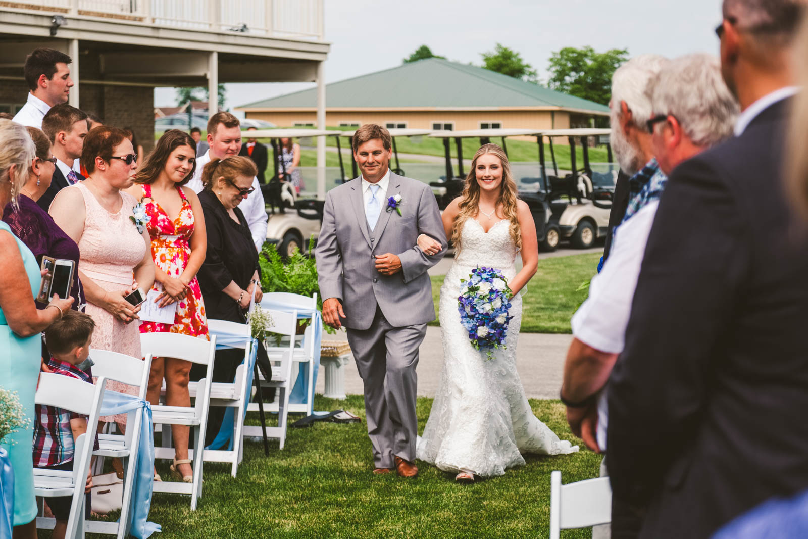 Bride Walks Down Aisle with Father on Wedding Day at Stone Ridge Golf Club in Bowling Green Ohio