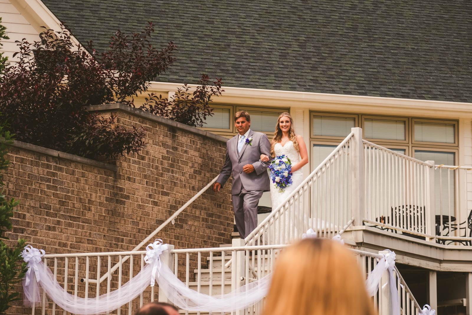 Father of Bride Walks Down Aisle on Wedding Day at Stone Ridge Golf Club