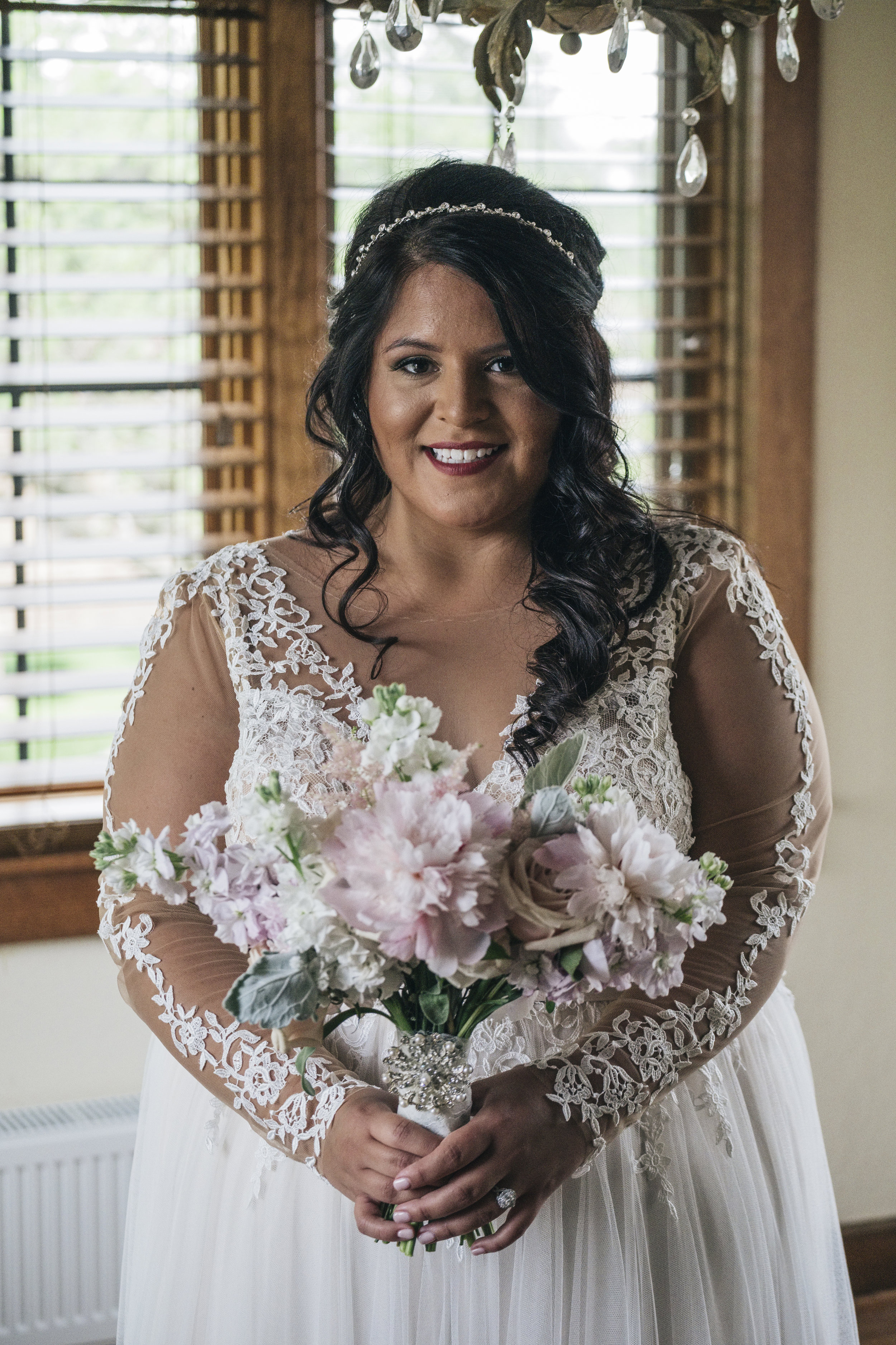 Bride with Bouquet Made by La Boutique Nostalgie on Wedding Day with Toledo Wedding Photographers