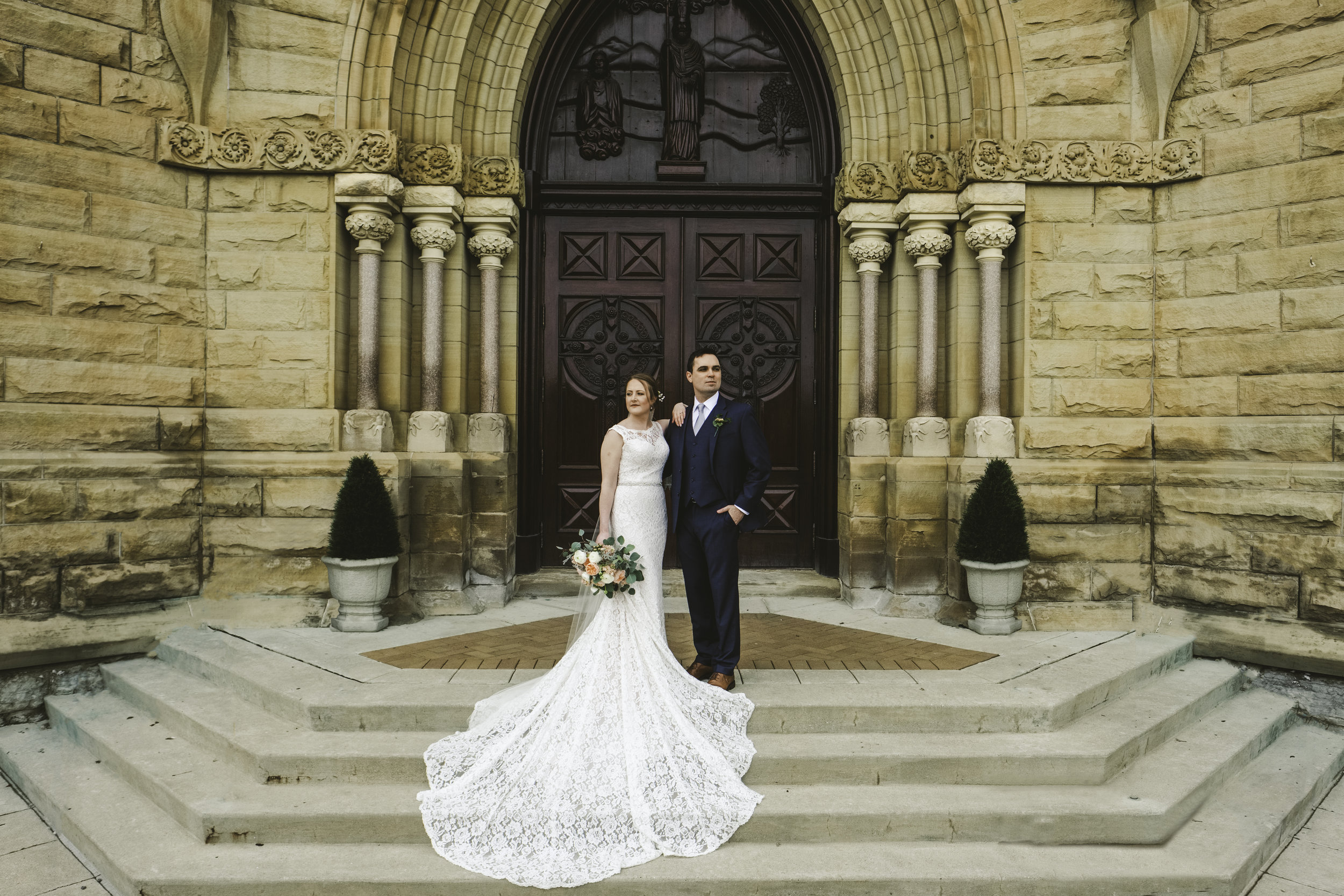 Couple at Historic Church of Saint Patrick with Toledo Wedding Photographers