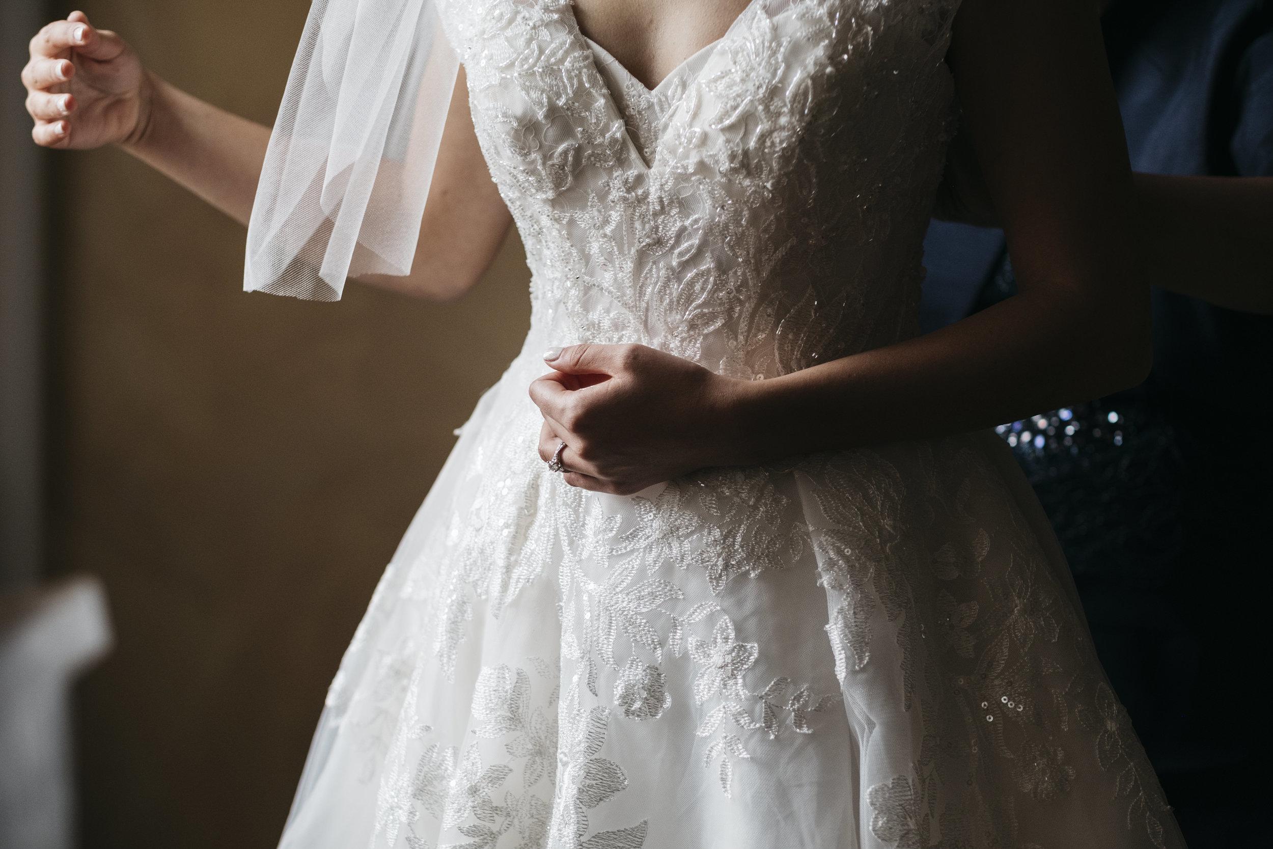 Bride Gets into Dress for Wedding with Toledo Ohio Photographers