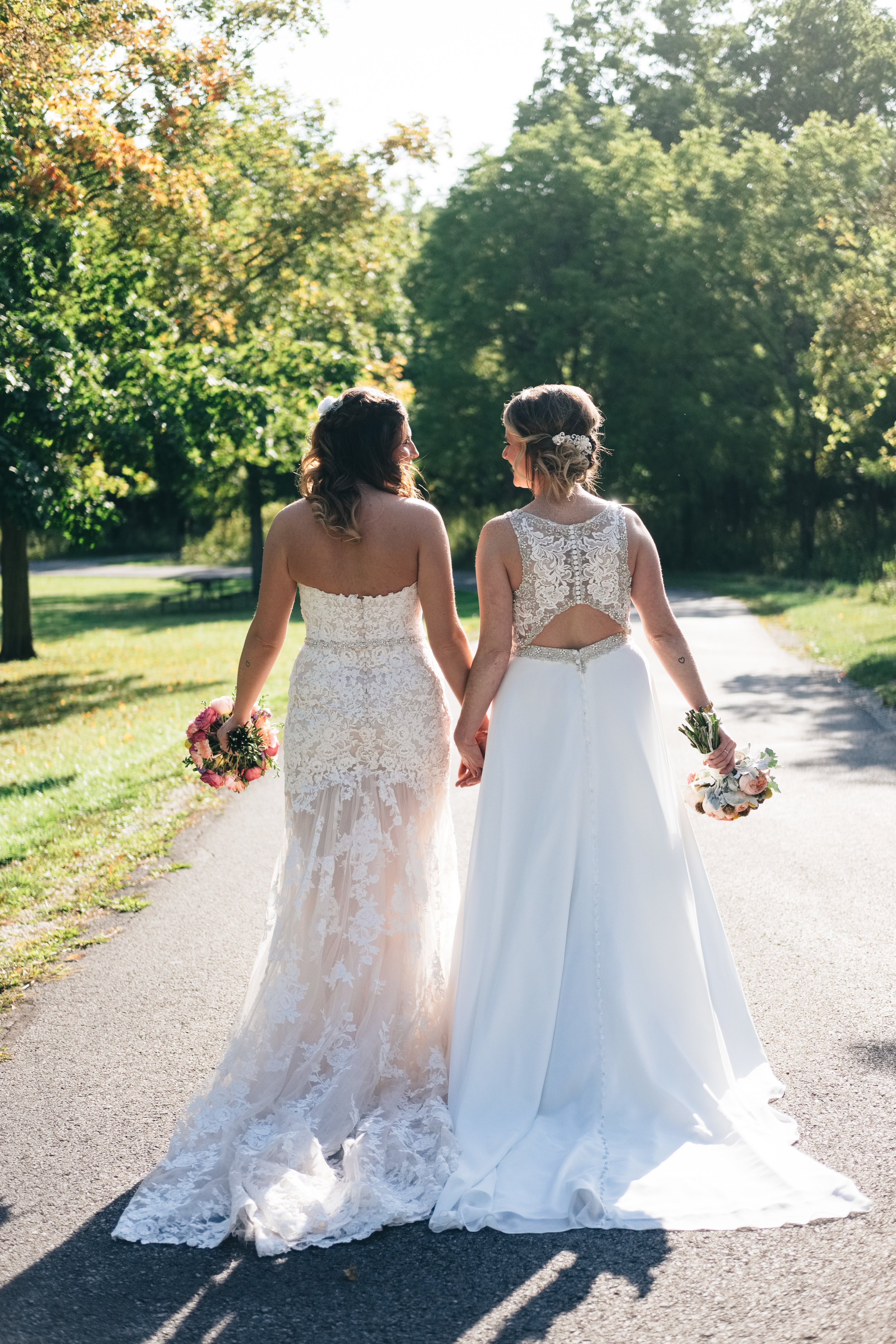Brides on Wedding Day at Same Sex Marriage with Wedding Dress Inspiration from Toledo Photographers