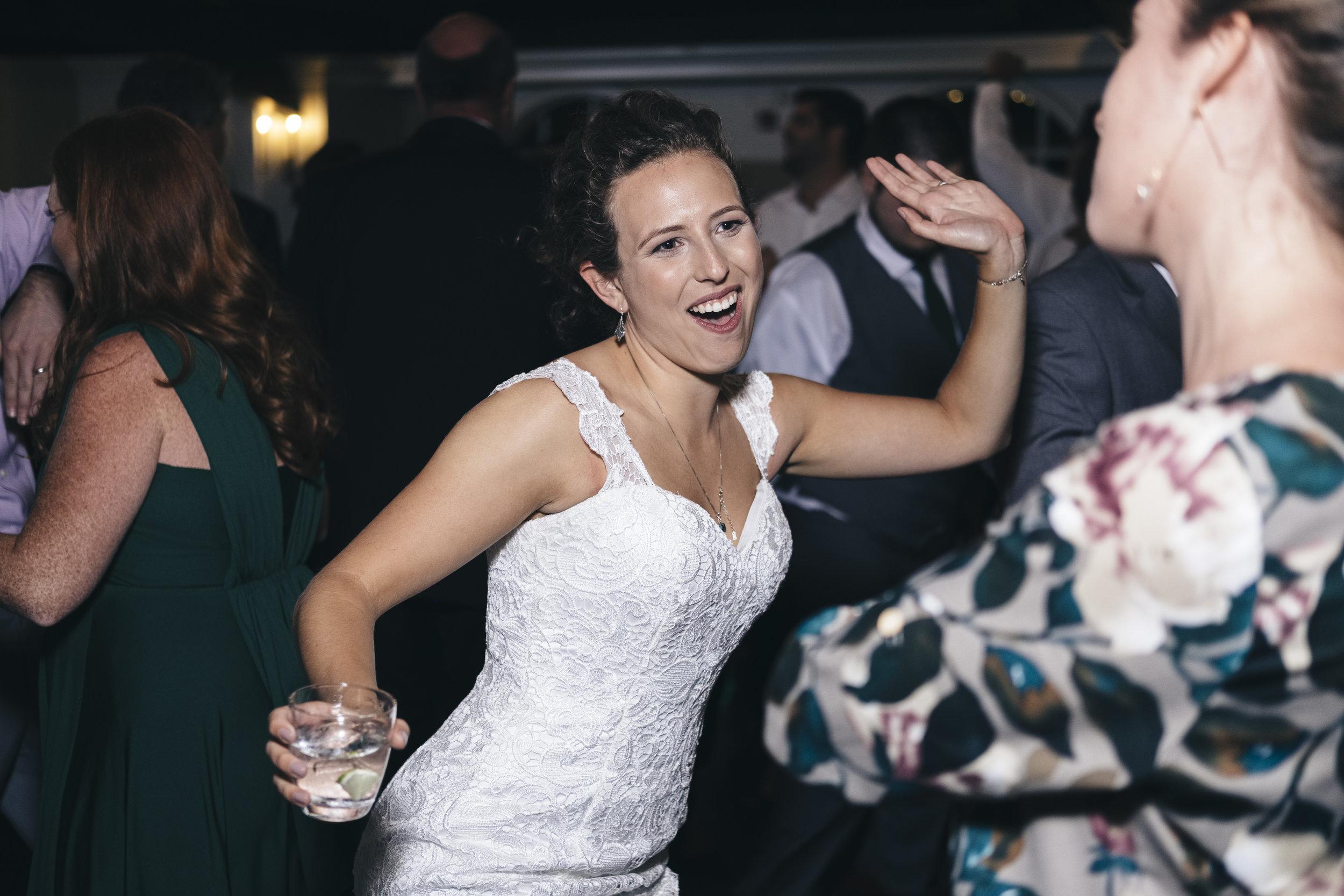 Bride in Toledo Ohio Dances at Her Wedding with Photographers