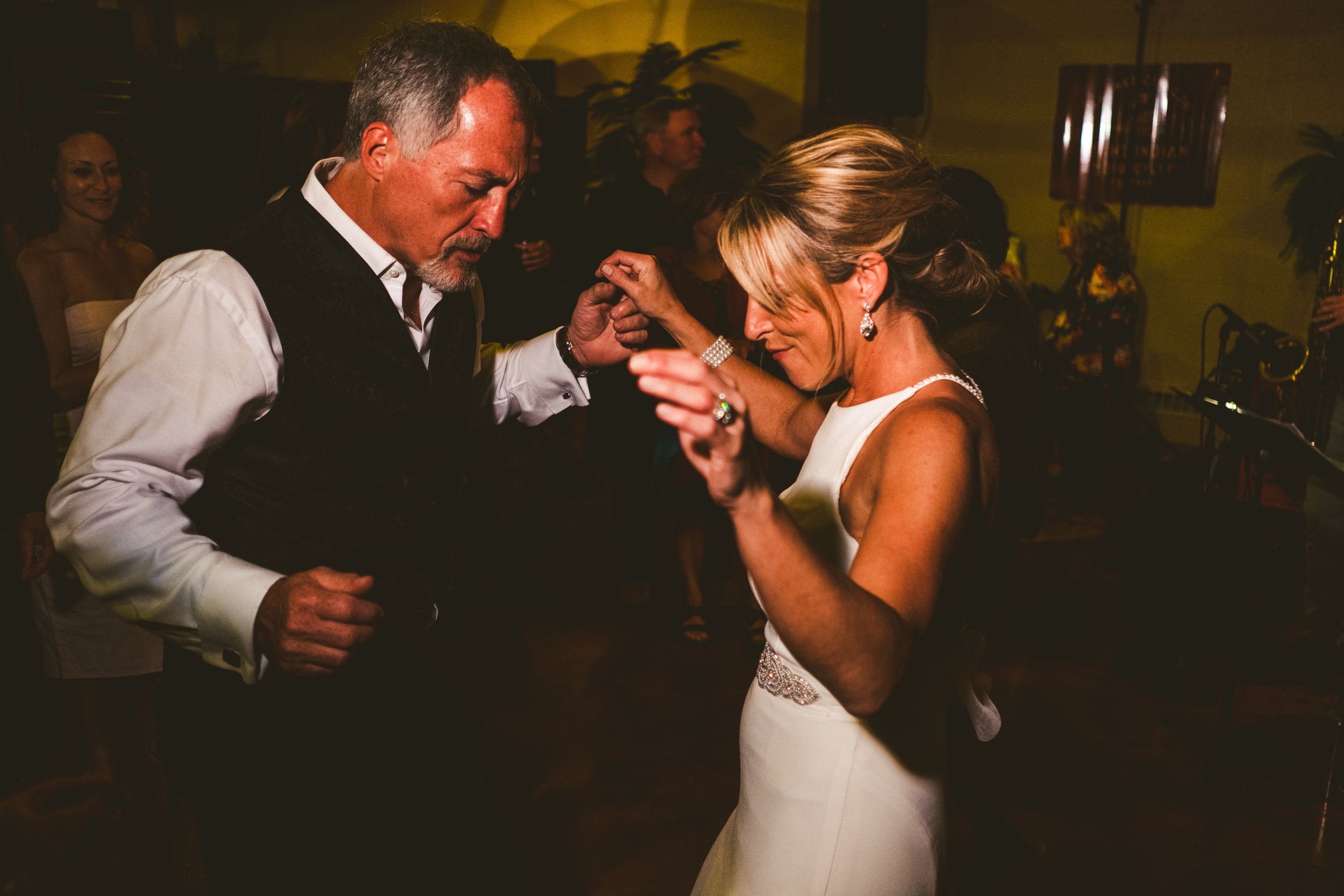 Bride and Groom Share First Dance at Wedding Reception in Toledo Ohio with Wedding Photographers