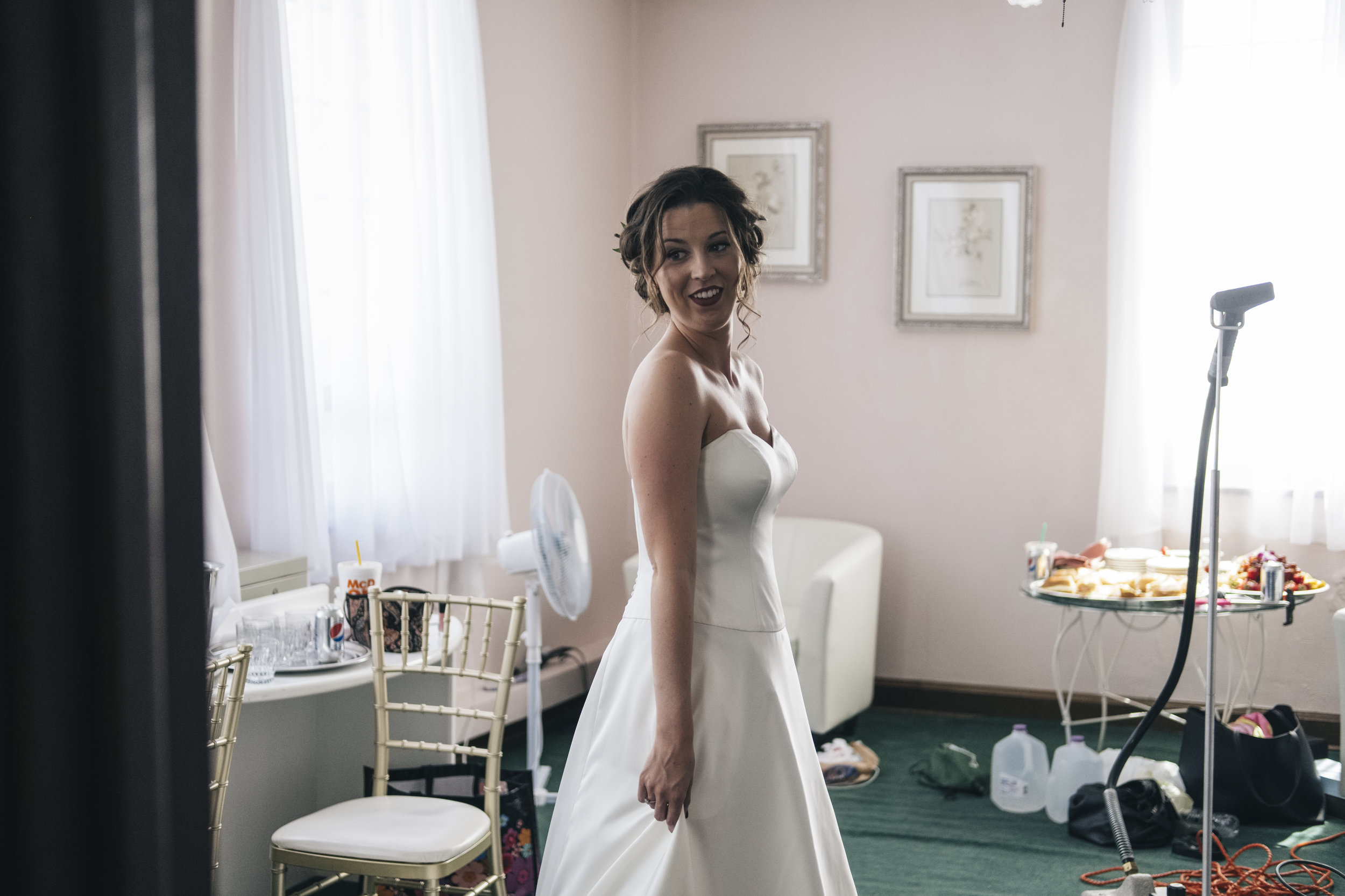 Bride Gets Ready for Ceremony in Toledo Ohio with Wedding Photographers