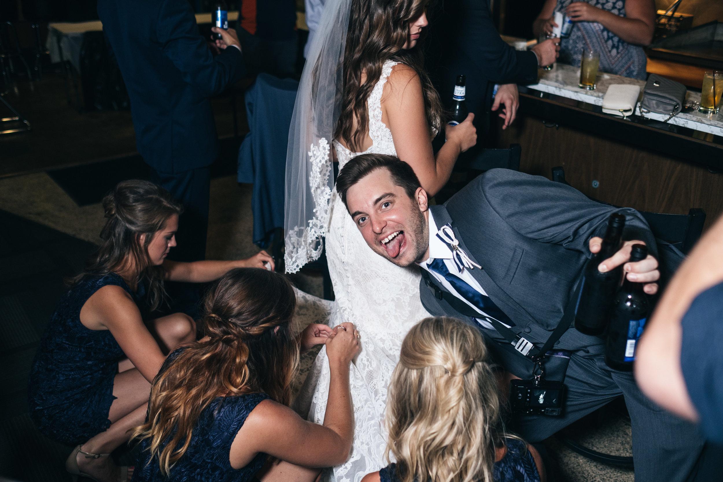 Bride gets her Wedding Dress Bustled with Toledo Ohio Wedding Photographers