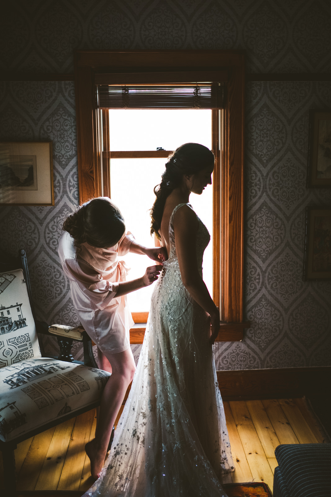 Bride Getting into Her Dress for her Wedding with Toledo Destination Photographers