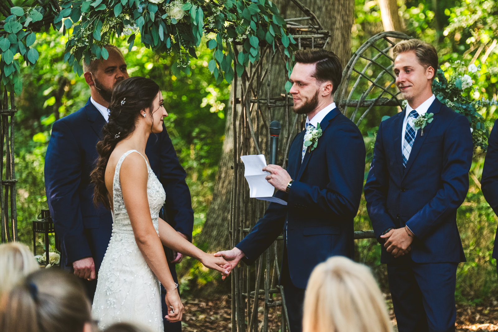 Groom on the verge of tears during outdoor ceremony in Milwaukee, Wisconsin.