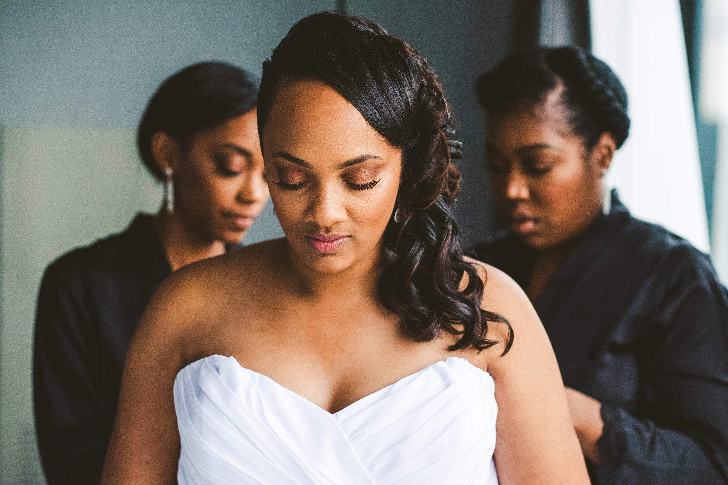Bride Gets into Wedding Dress with Toledo Ohio Wedding Photographers at the Renaissance Downtown Toledo Hotel