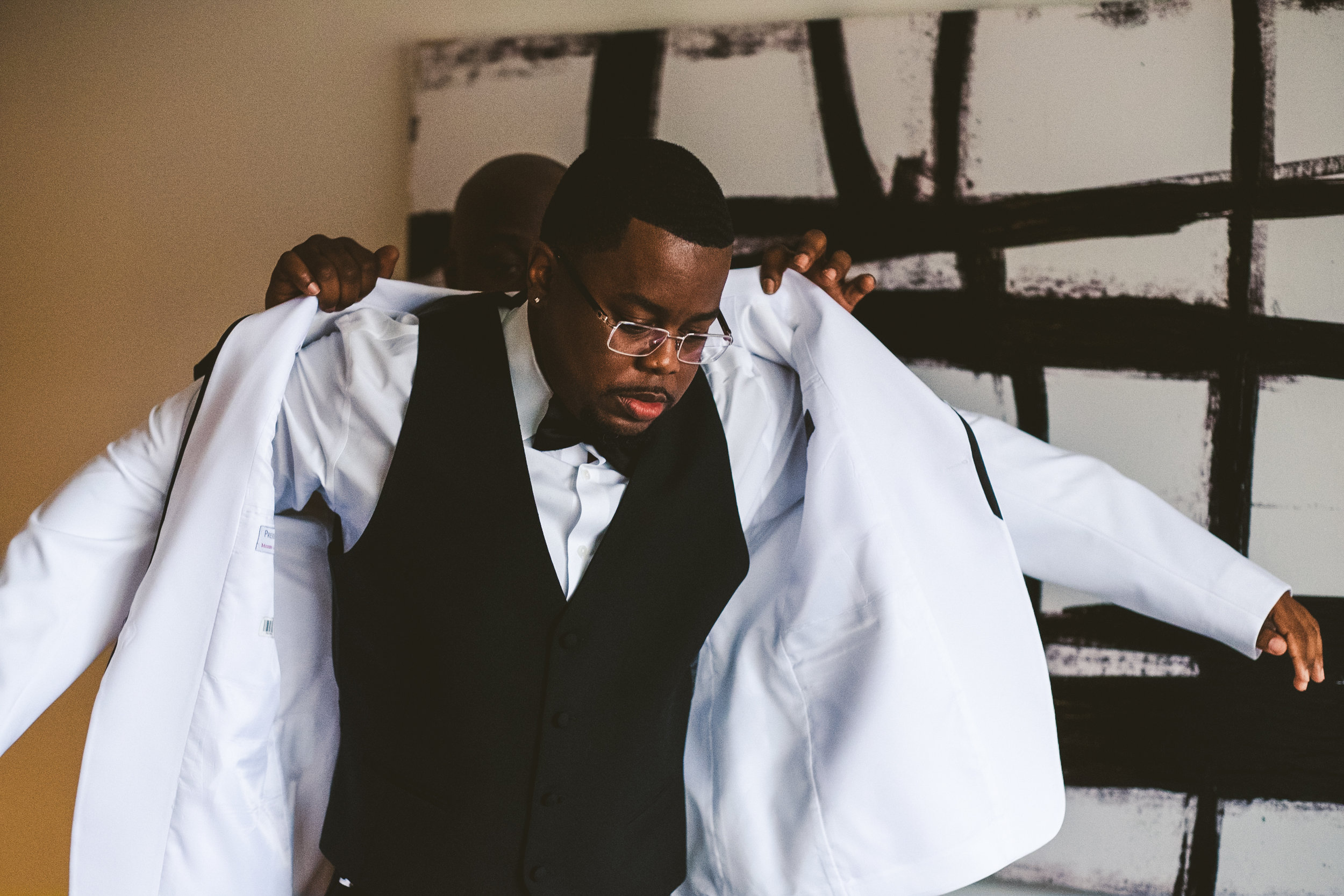 Groom Gets Ready for Wedding with Wedding Photographers from Toledo Ohio at the Downtown Toledo Renaissance Hotel