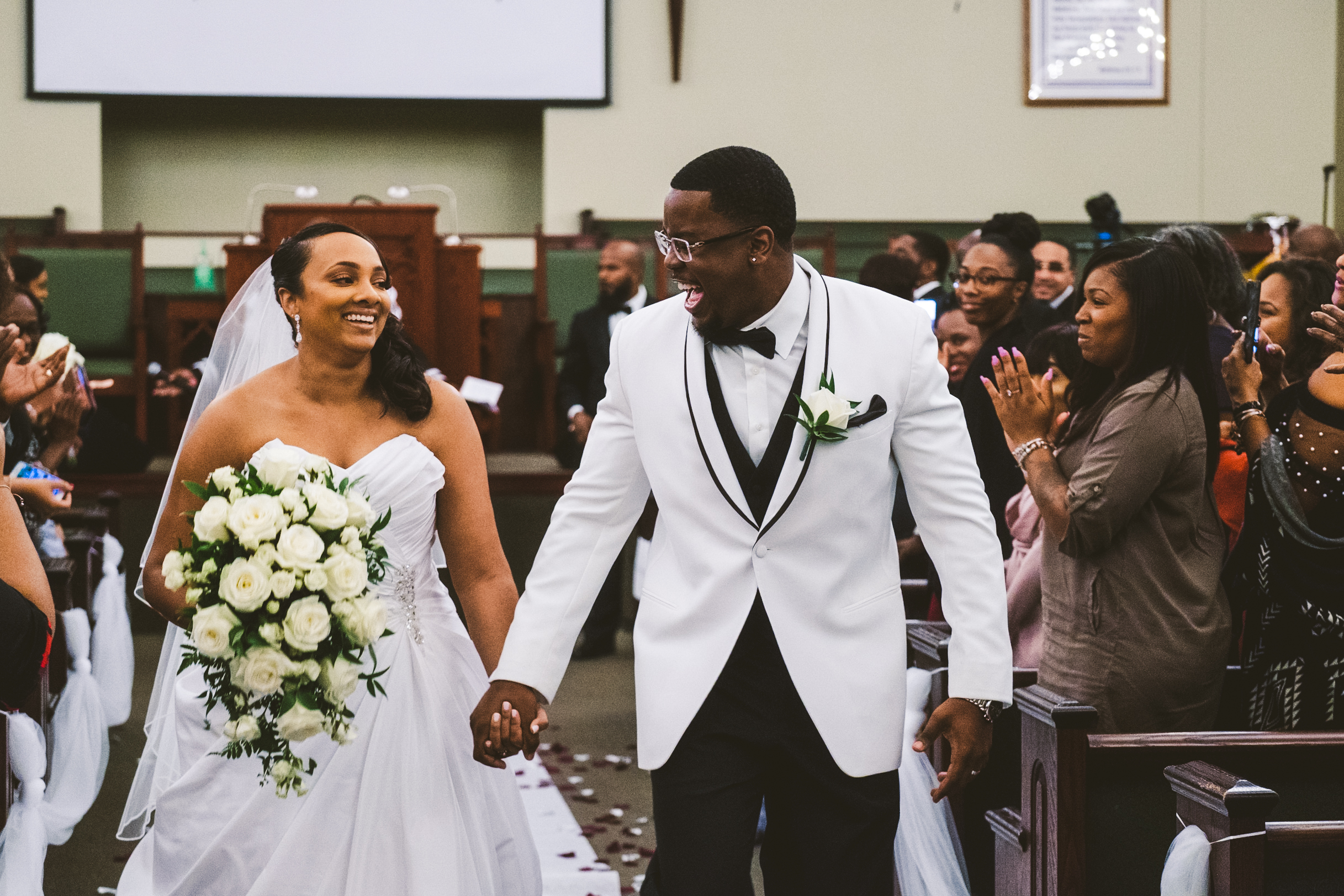 Bride and Groom with Toledo Ohio Wedding Photographers Exit Ceremony on Wedding Day