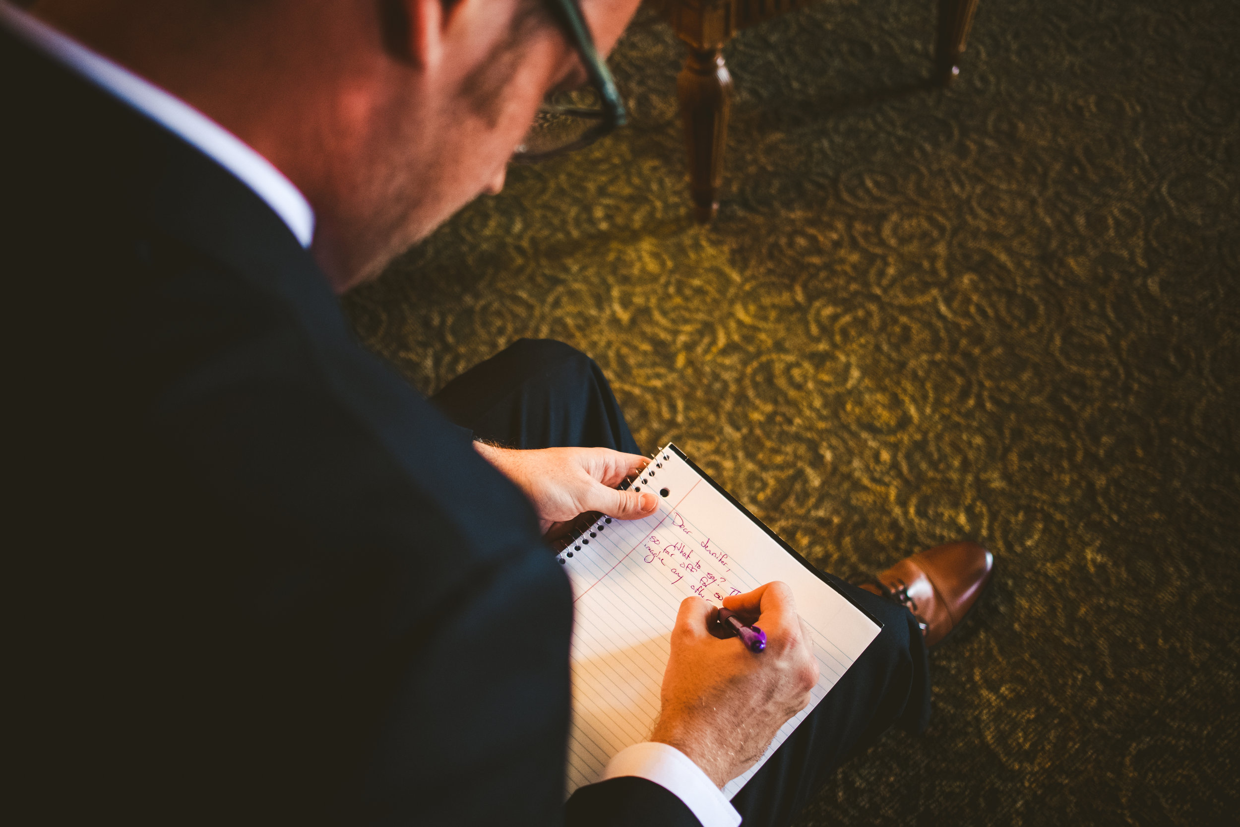 Toledo Ohio Groom with Toledo Wedding Photographers on Wedding Day Writing Vows Before Wedding