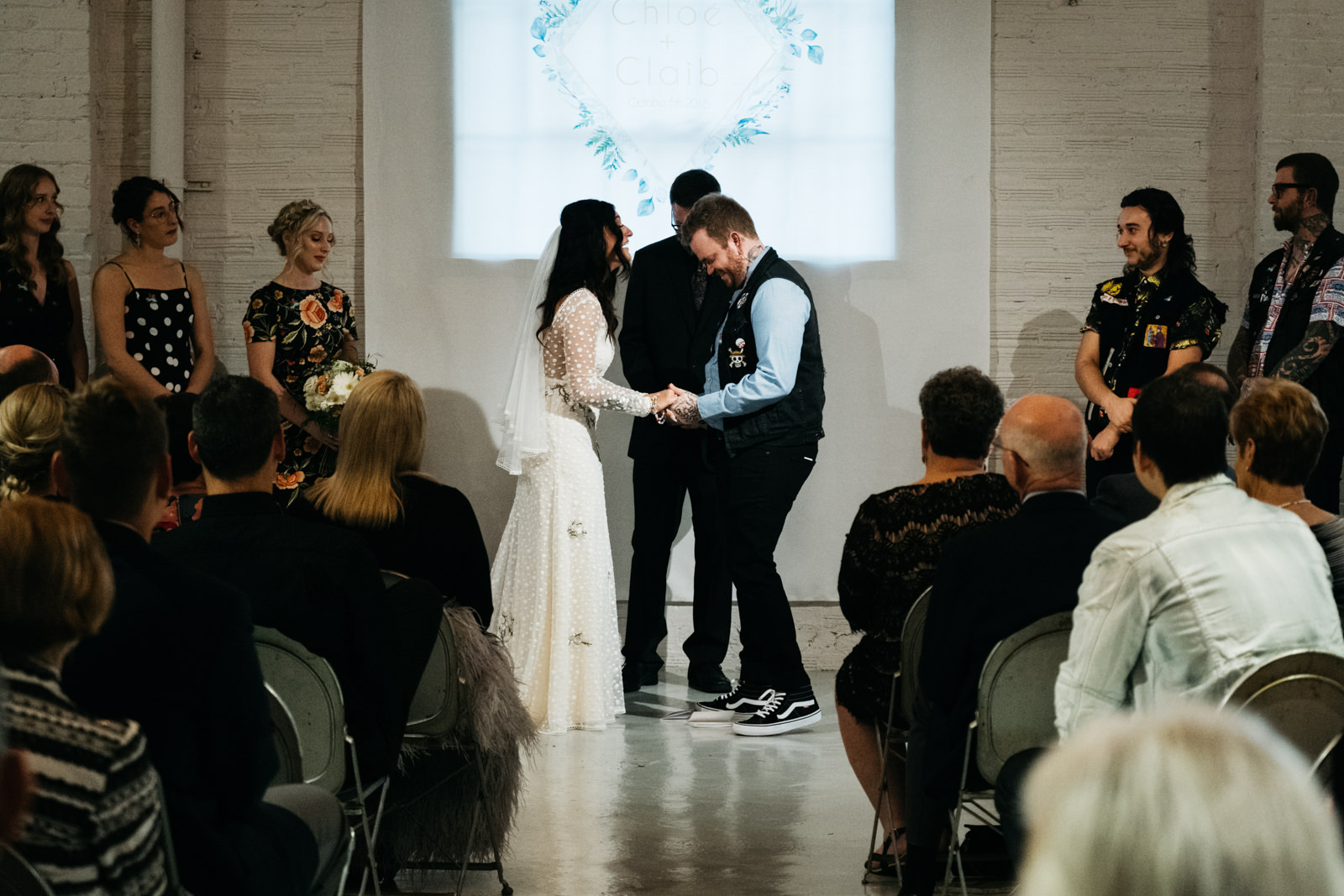 Bride and Groom's Ceremony at Growing Hope Market Place with Michigan Wedding Photographers in Ypsilanti