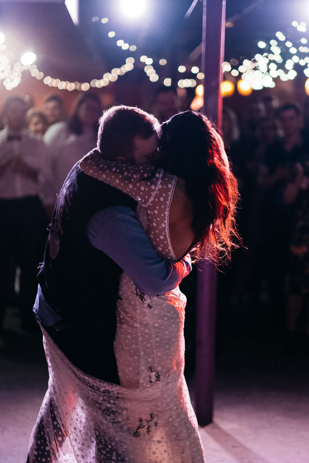 Bride and Groom Share First Dance at Reception in Bona Sera Restaurant with Toledo Ohio Destination and Wedding Photographers