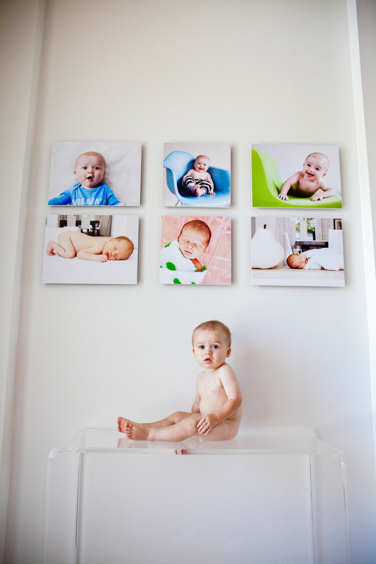 - Are you enjoying art of your family on your walls and in albums every day? I hope so.This portrait illustrates a growing collection in one of our clients' homes. Here you see a little man at his one year session....and above him are some keepsakes from his newborn and sixth month portrait sessions.Guess who is adding three more images to this collection? This guy!