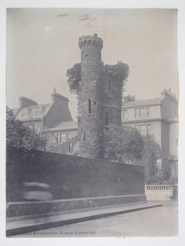 """This photograph from the early 1900s shows the remains of tower that stood in the grounds of Campden House.""—   Library Time Machine  ."