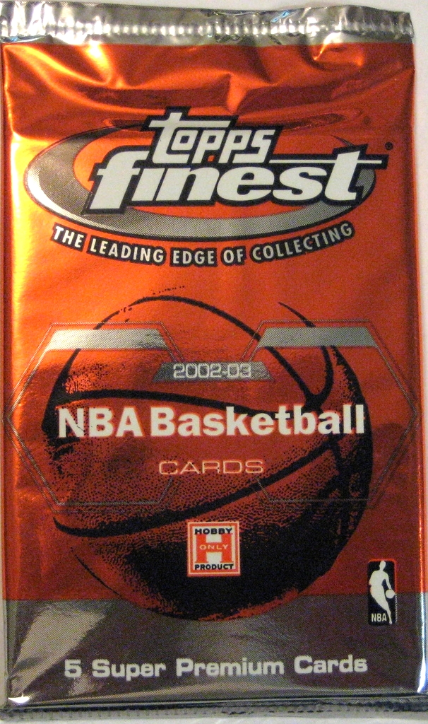 2002-03 Topps Finest Basketball Pack: Finally, a return from the doldrums of 1999-2001. That orange is a bold choice as it could seem a bit obvious for a basketball pack, but it looks fabulous.