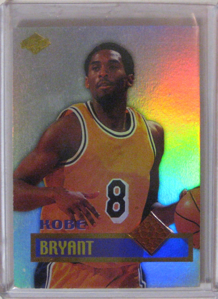 1999 Collector's Edge Game Ball Kobe Bryant: Interestingly, you can tell that Collector's Edge doesn't have a license to print proper cards, because they can't show the Lakers logo. There is a bit of game-used ball embedded in this card.