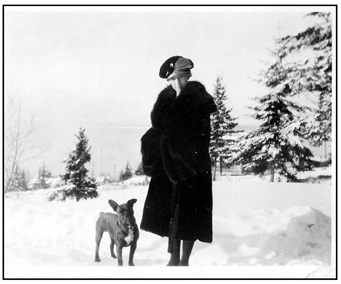 Photo of Birdie Neill Torney modeling a lovely fur coat (dog's name unknown). Courtesy Gary Gordon.