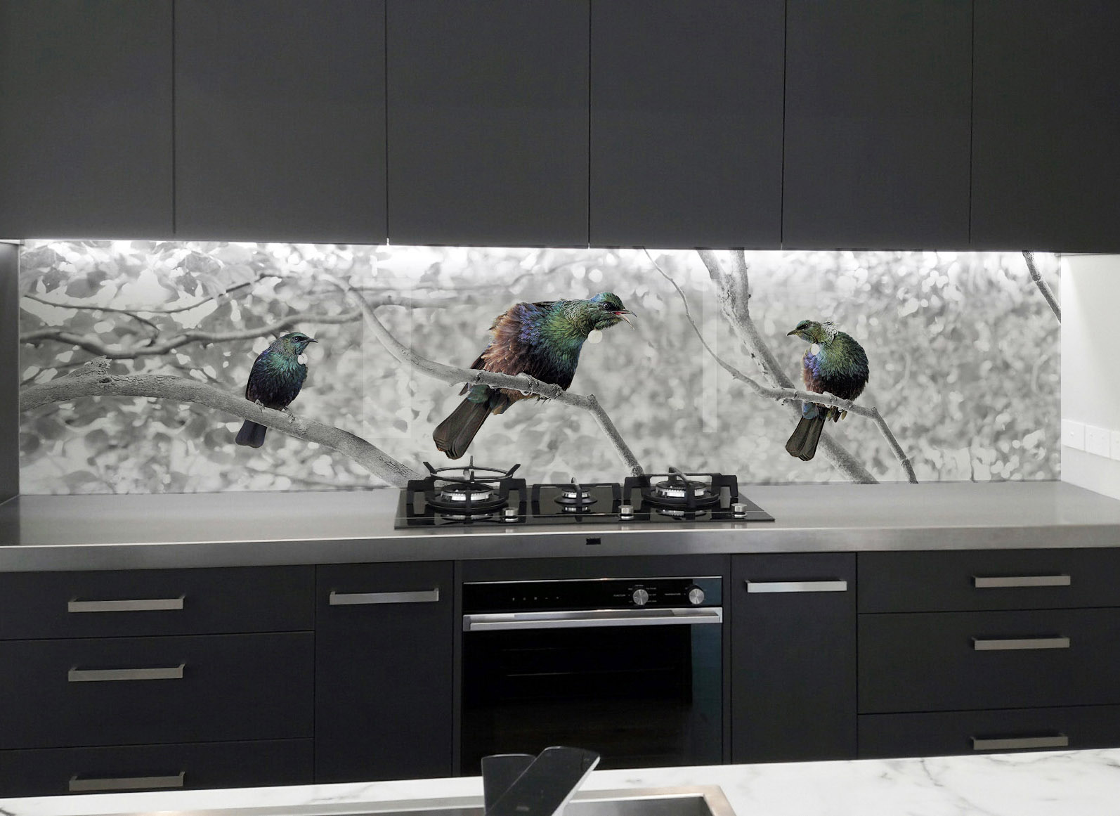 Dark cabinetry ? - Choose an image with lots of light tones as a dark image will look too dark in the overall space and install overhead recessed cabinetry lights or an LED strip light to illuminate the splashback.