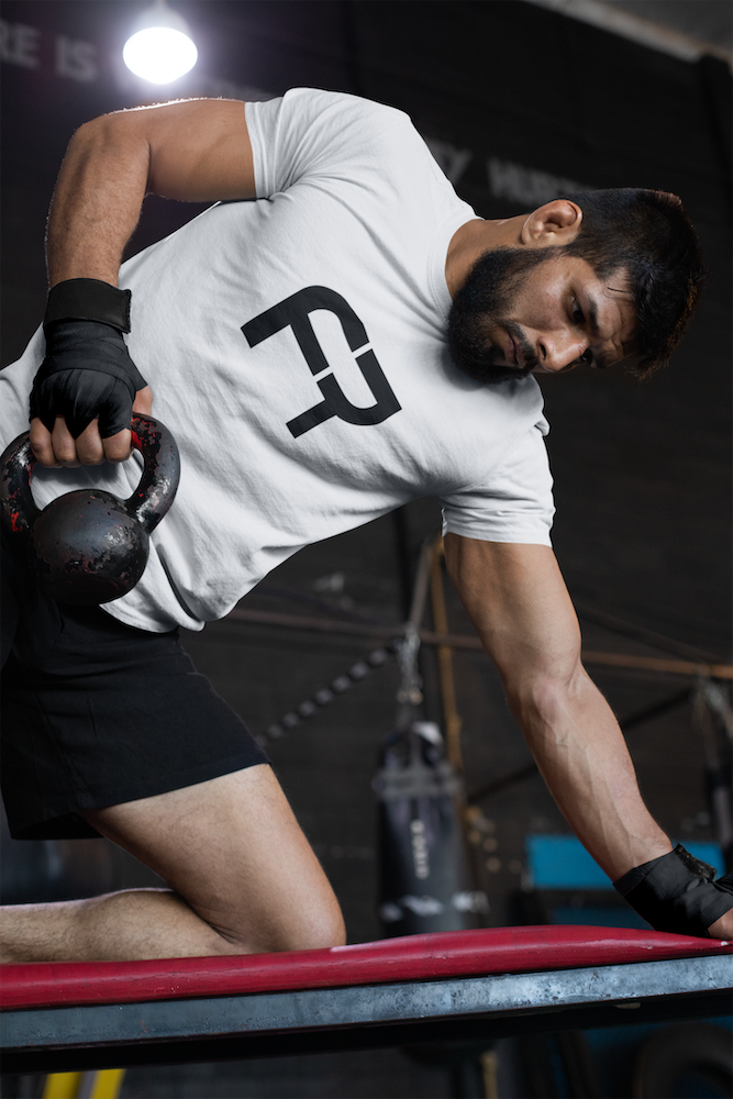 tee-mockup-of-a-muscular-man-training-at-the-gym-26251.png