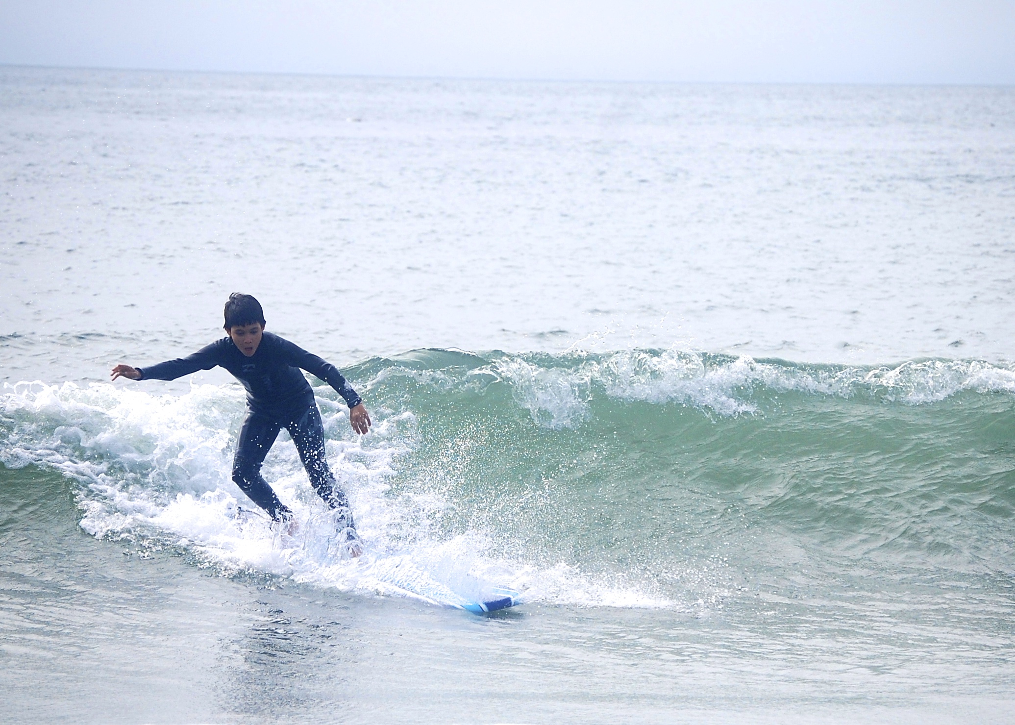 12 year old catching a big wave