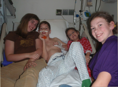 Robbie with his sister Bethany (left) and his Wornock cousins, Abby & Katie (right)