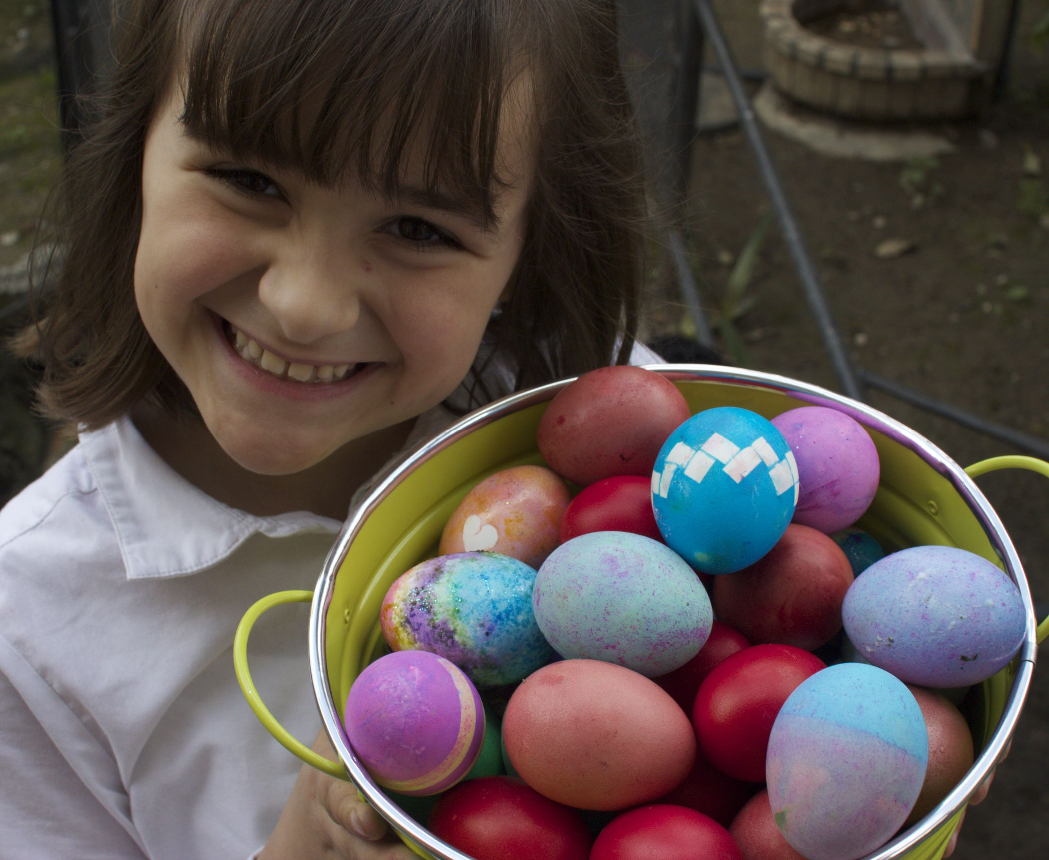 Jillian with a bucket-o'-eggs (we couldn't find any baskets).