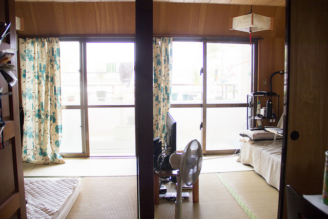View of the two tatami rooms and the moveable barrier between them. You could open up the sliding wooden doors in the middle and have one big room, or you can separate them into 2 rooms. Note the tatami mats on the floor.