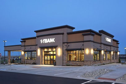 For this new branch of 1stBank in Aurora, the bank employed   beautiful wood framing to accompany its style.