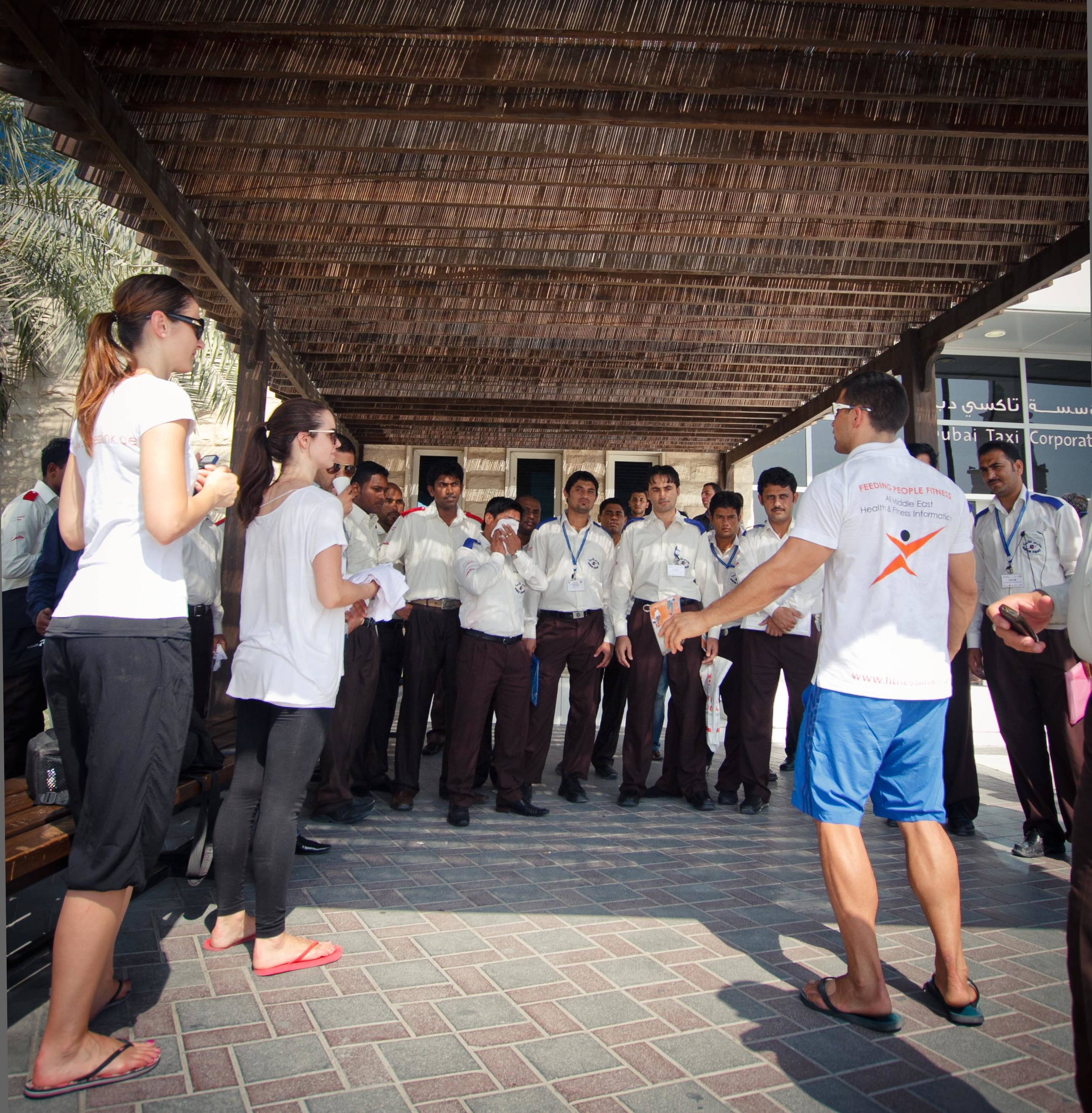 FitnessLink Co-Founder Grant Goes demonstrates some stretches and offers health advice to a group of RTA Taxi Drivers.