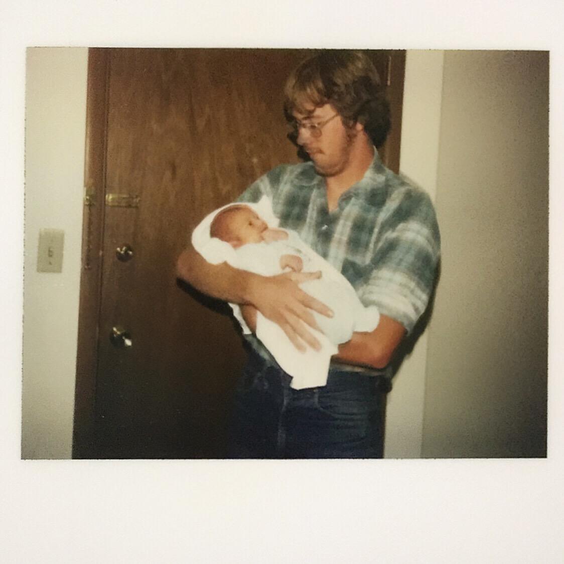 polaroid dad baby