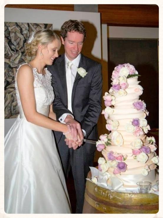 Sally & Sean Cutting  the Cake.jpg