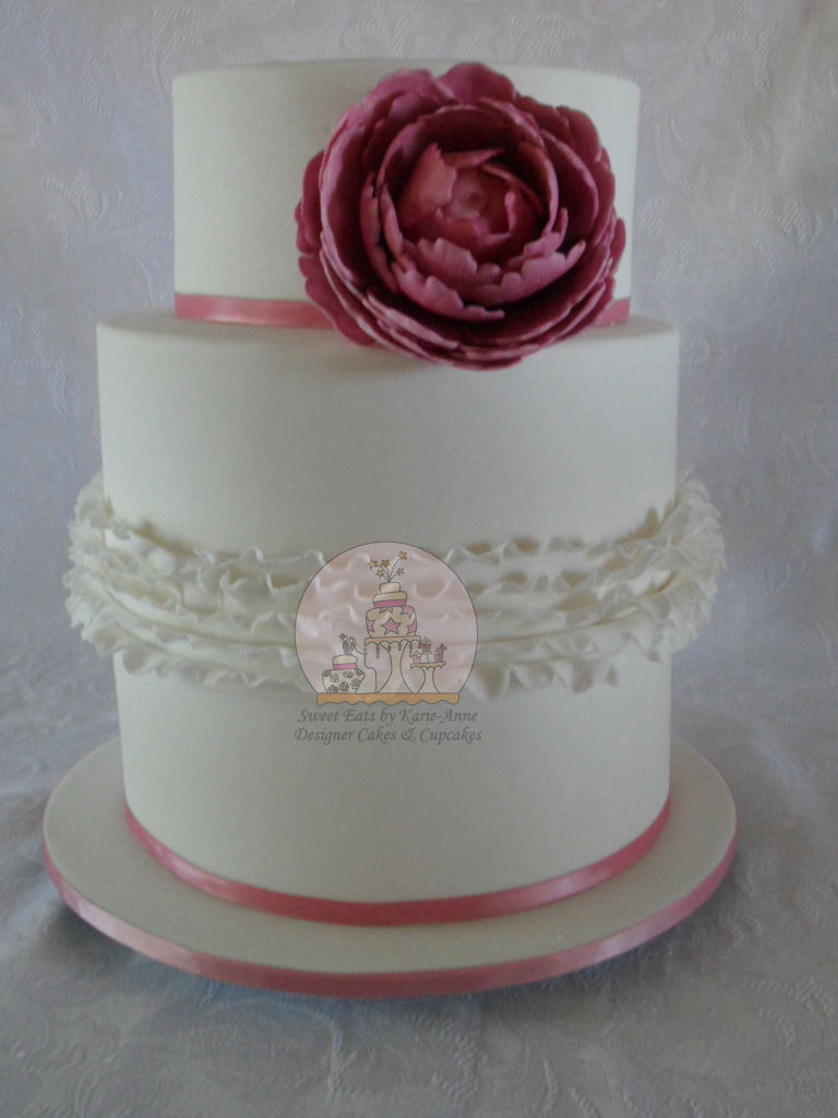 """Nick & Arienne's Wedding Cake """"Touch of Ruffles"""" with a Fondant Peonie Flower."""